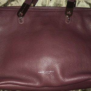 Burgundy leather good. Marc Jacob